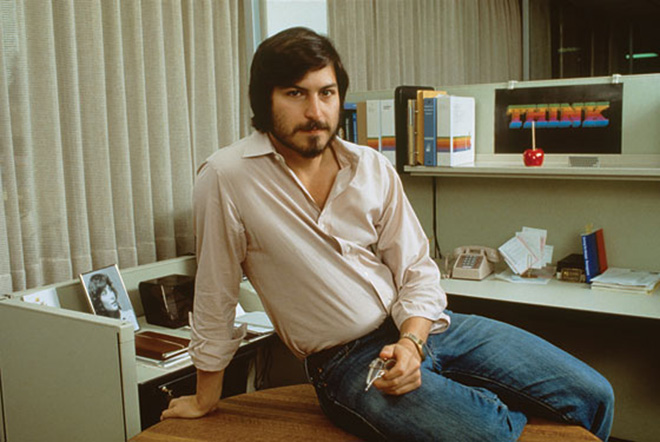 A young Steve Jobs in his office