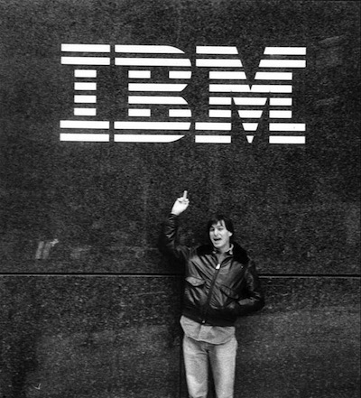 Steve Jobs pictured under IBM logo