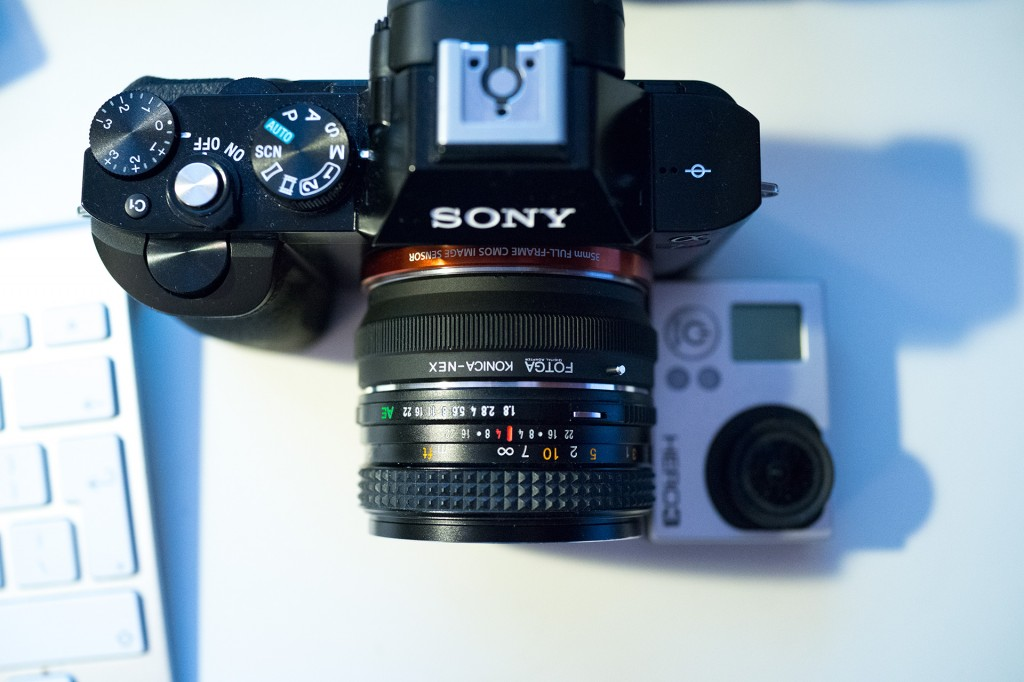 Size comparison: Sony A7R with small Konica lens compared to GoPro