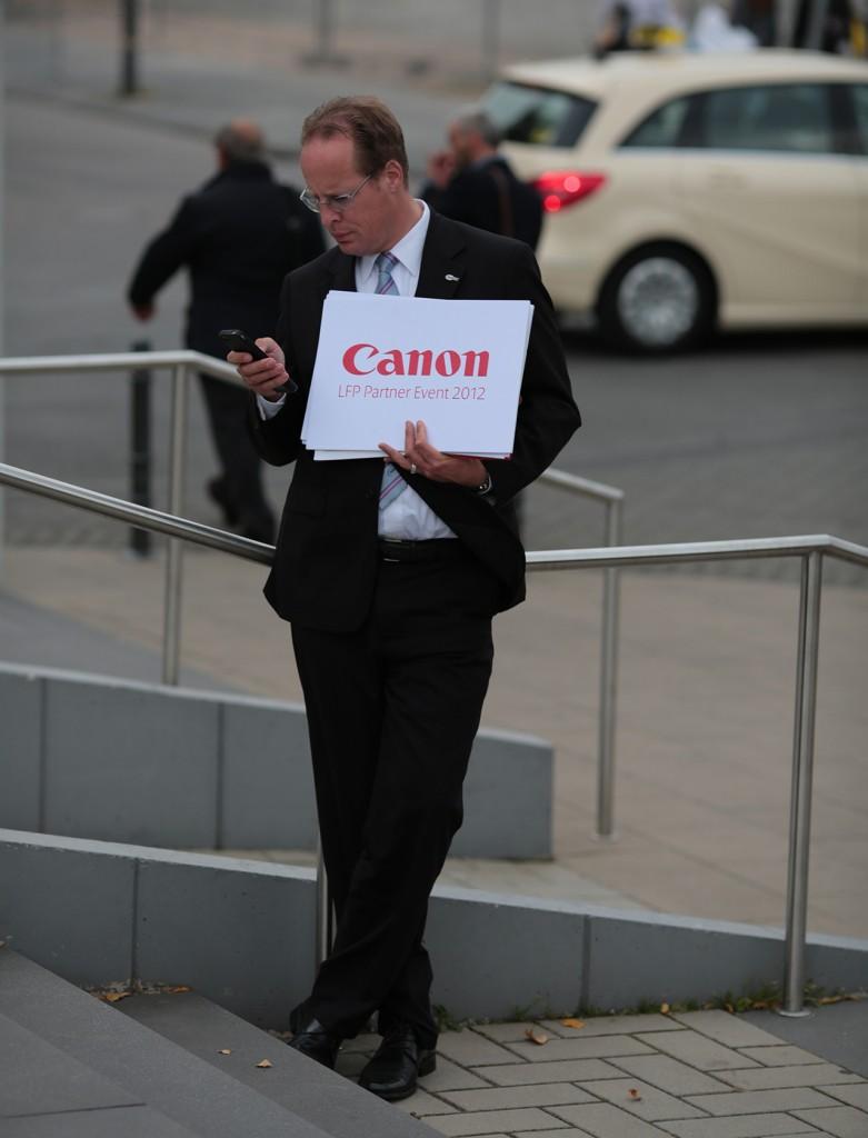 Canon man waits at Photokina