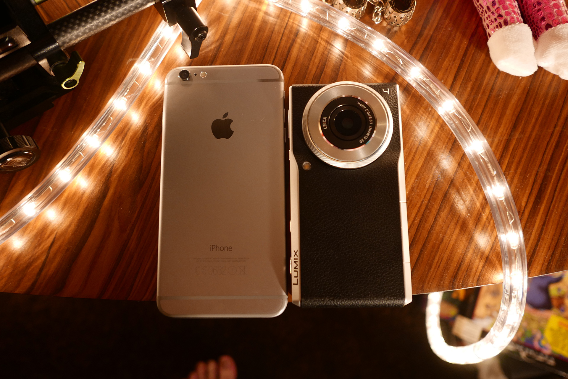 The CM1 next to the iPhone 6 Plus